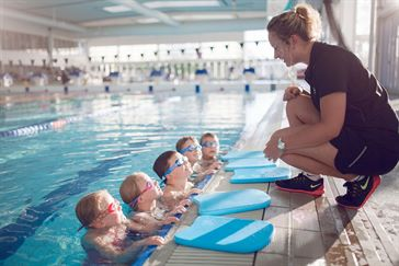 Swim instructor and students