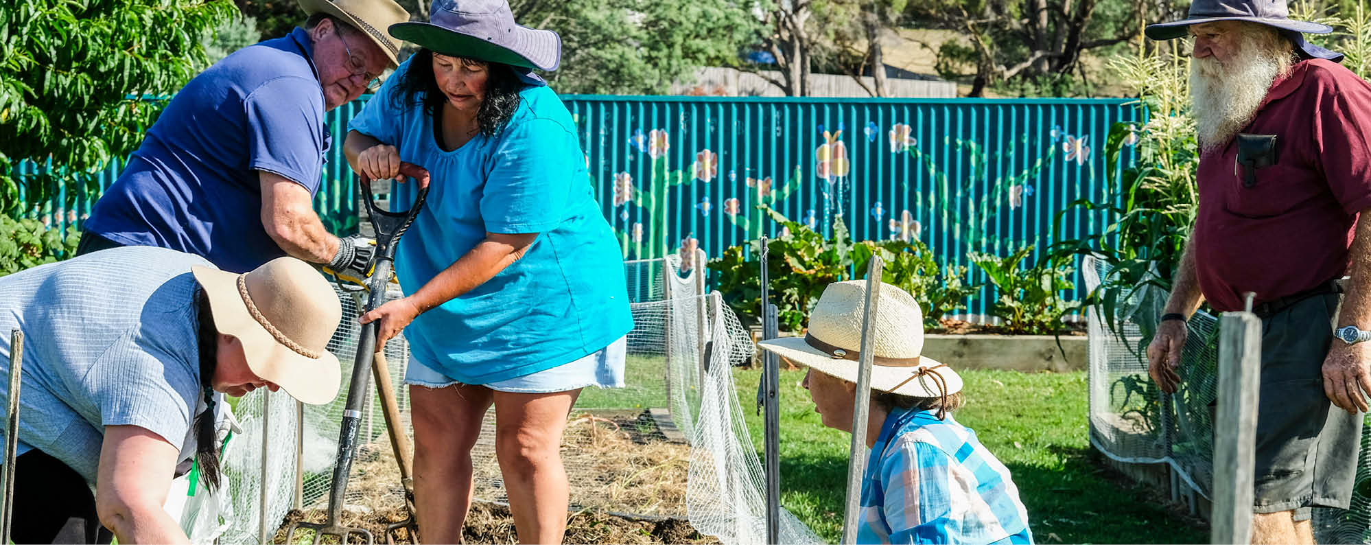 Community members working on a garden in the Northern Suburbs of Launceston